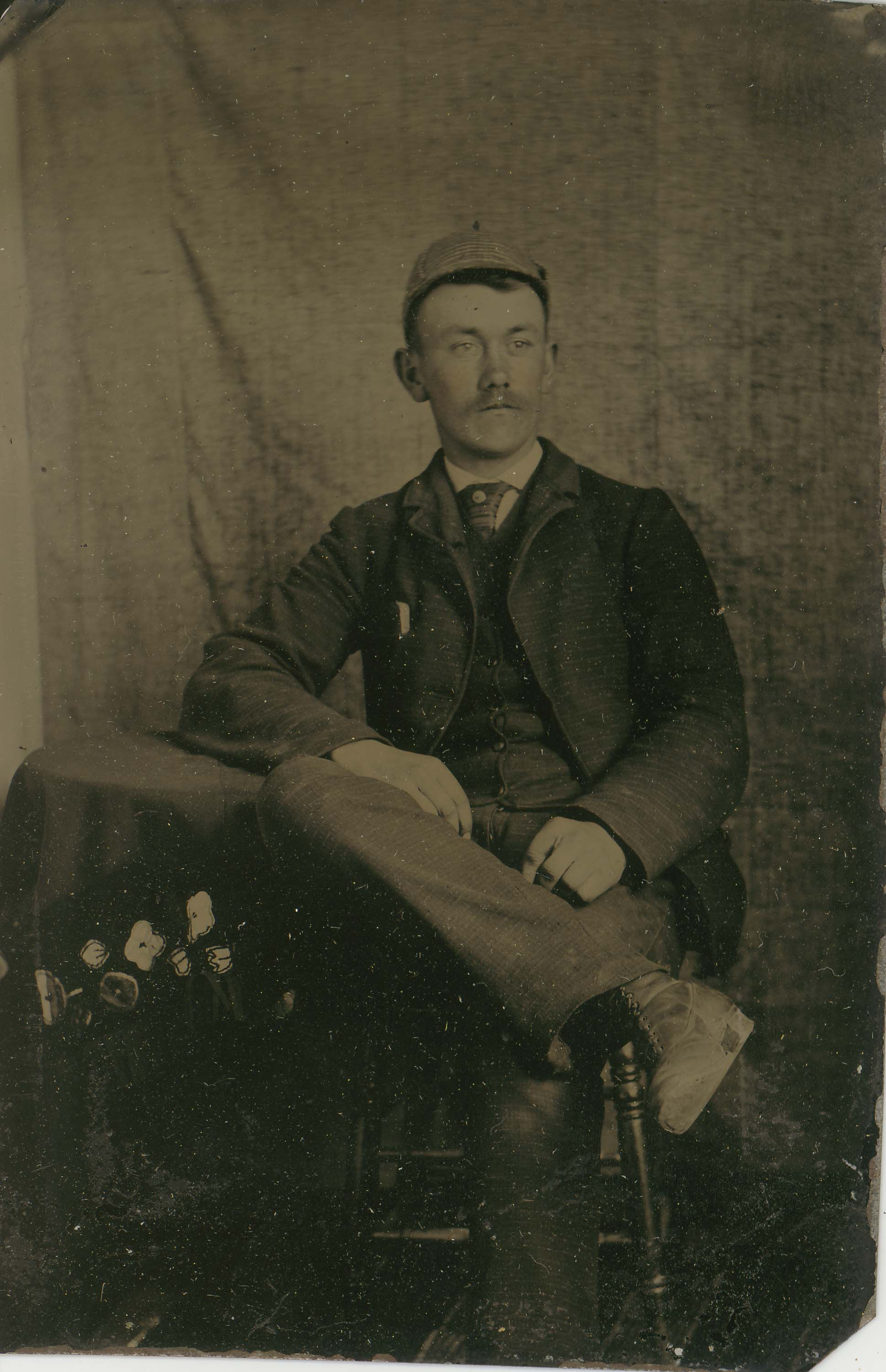 Tin-type-1-Man-seated-at-table-with-cap