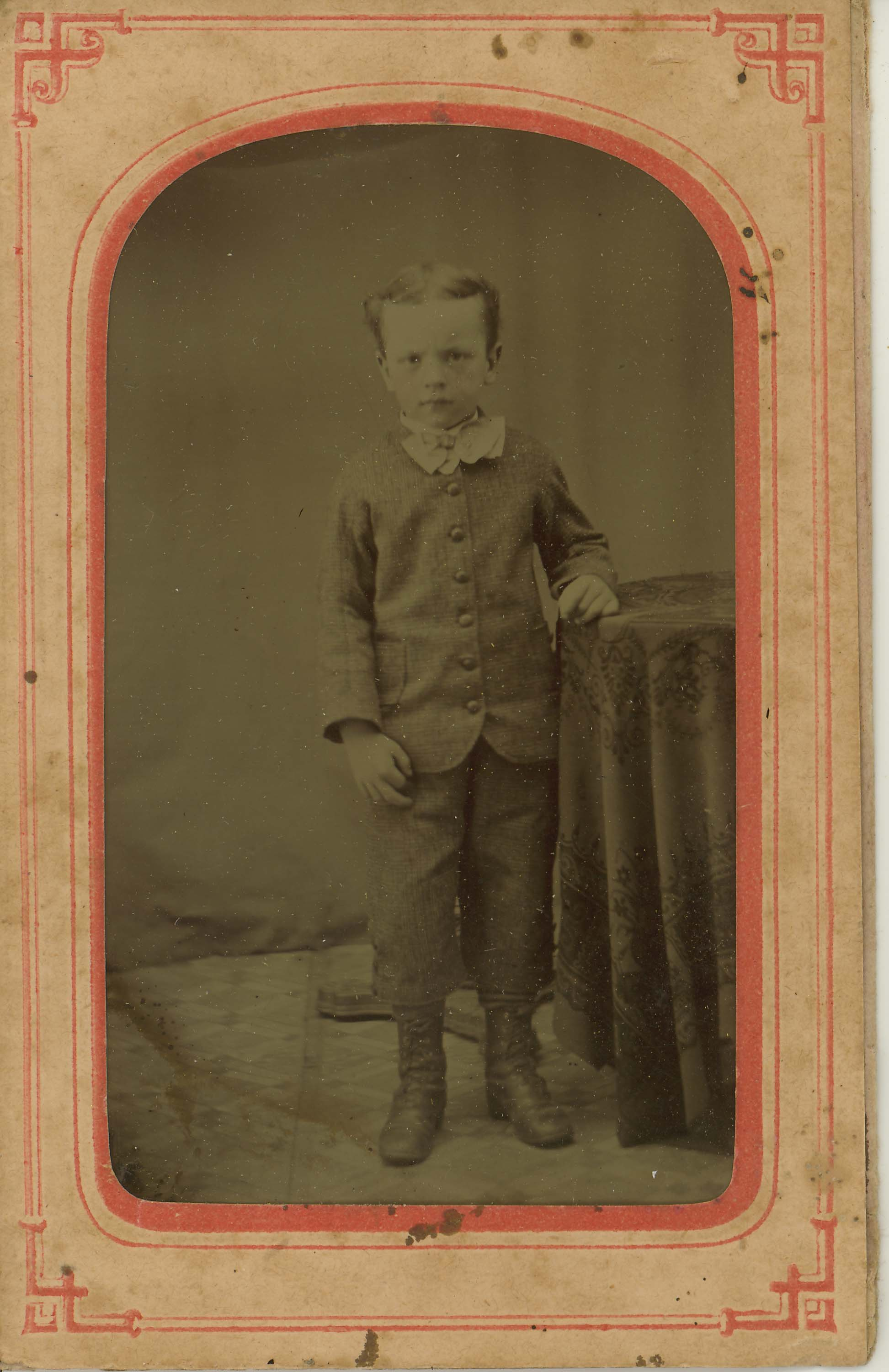 Tin-type-13-Small-boy-mounted-in-arched-pink-and-red-matt