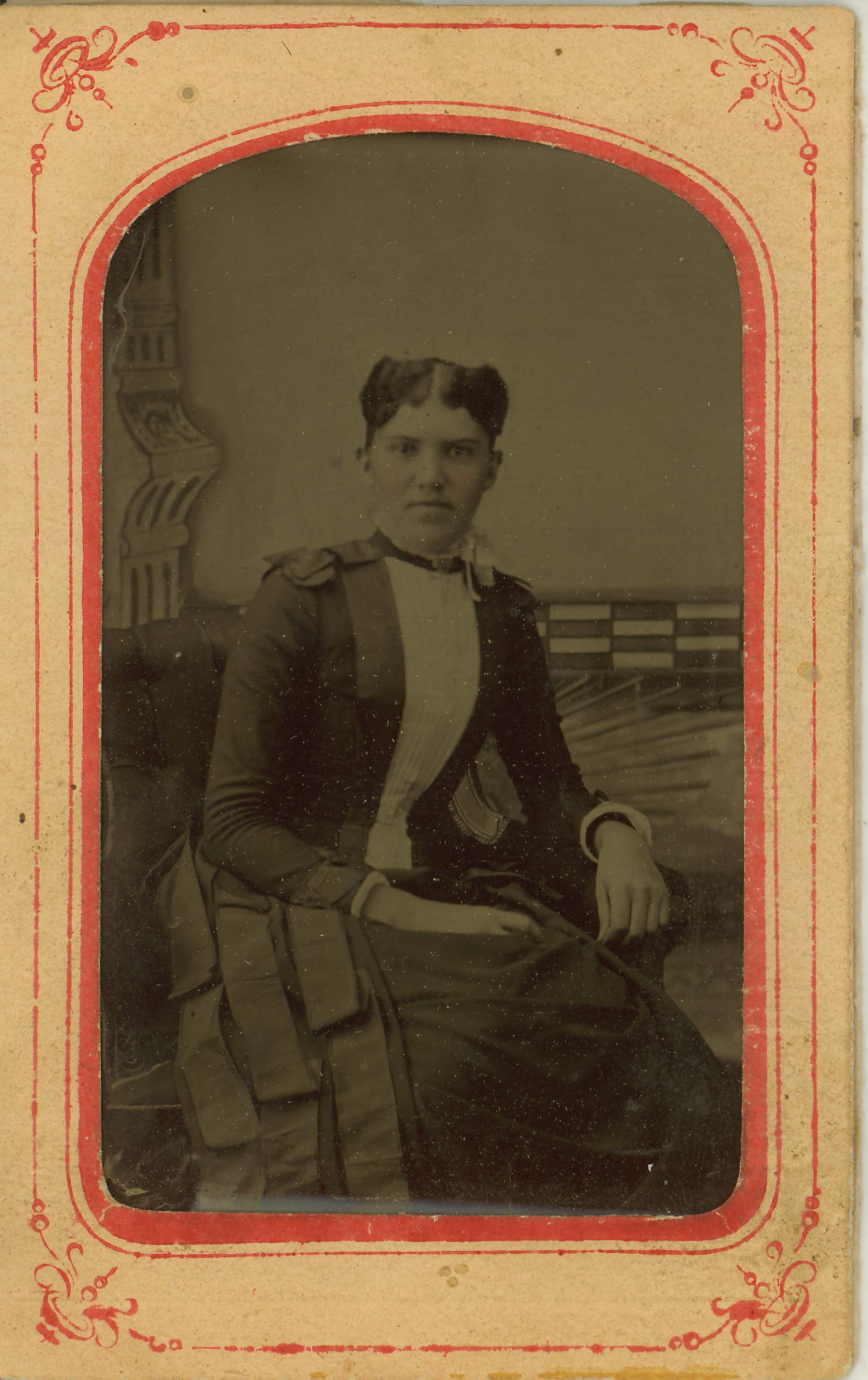 Tin-type-15-Portrait-of-seated-woman-mounted-in-arched-pink-and-red-matt