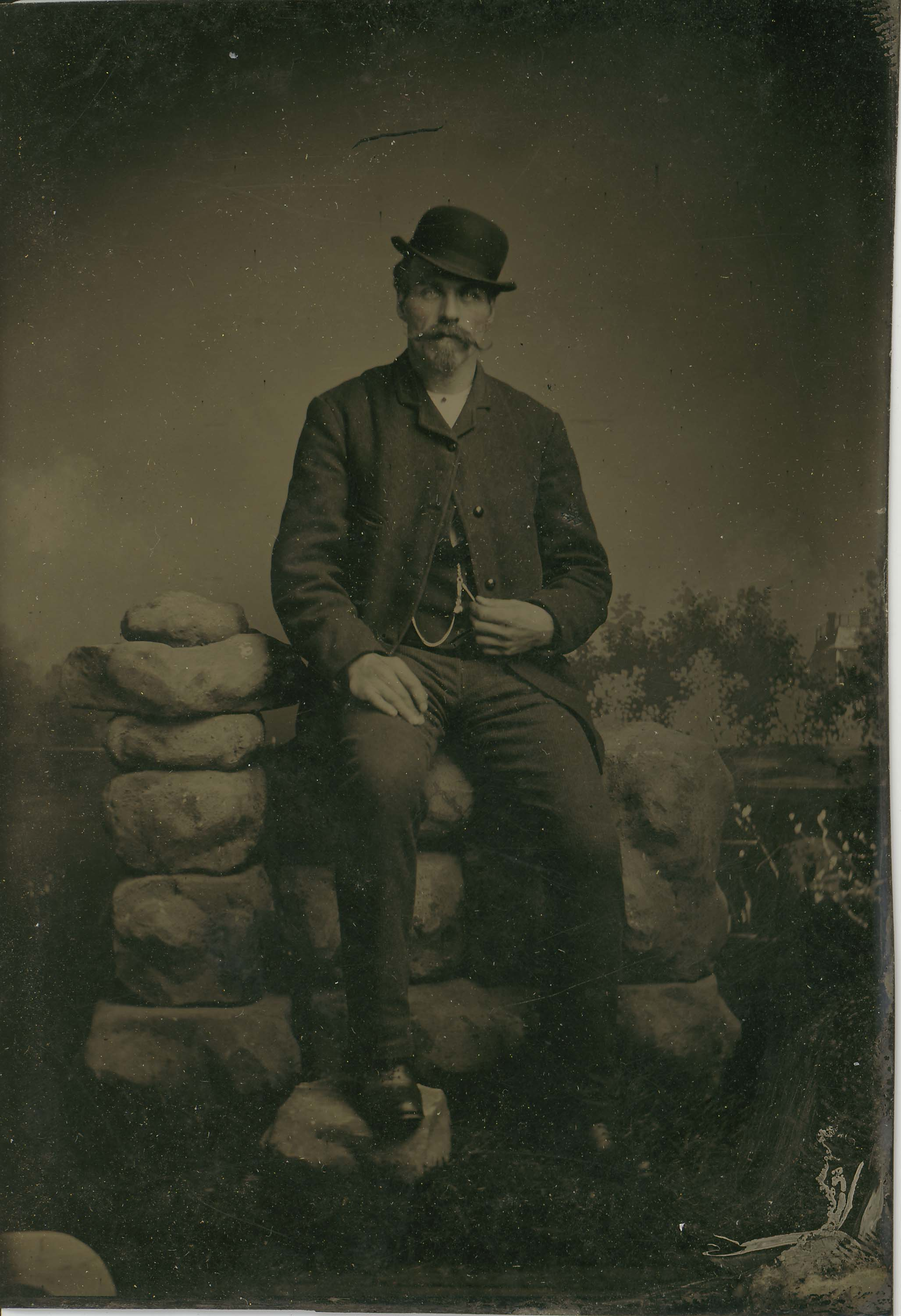 Tin-type-4-Man-seated-on-rock-Wall