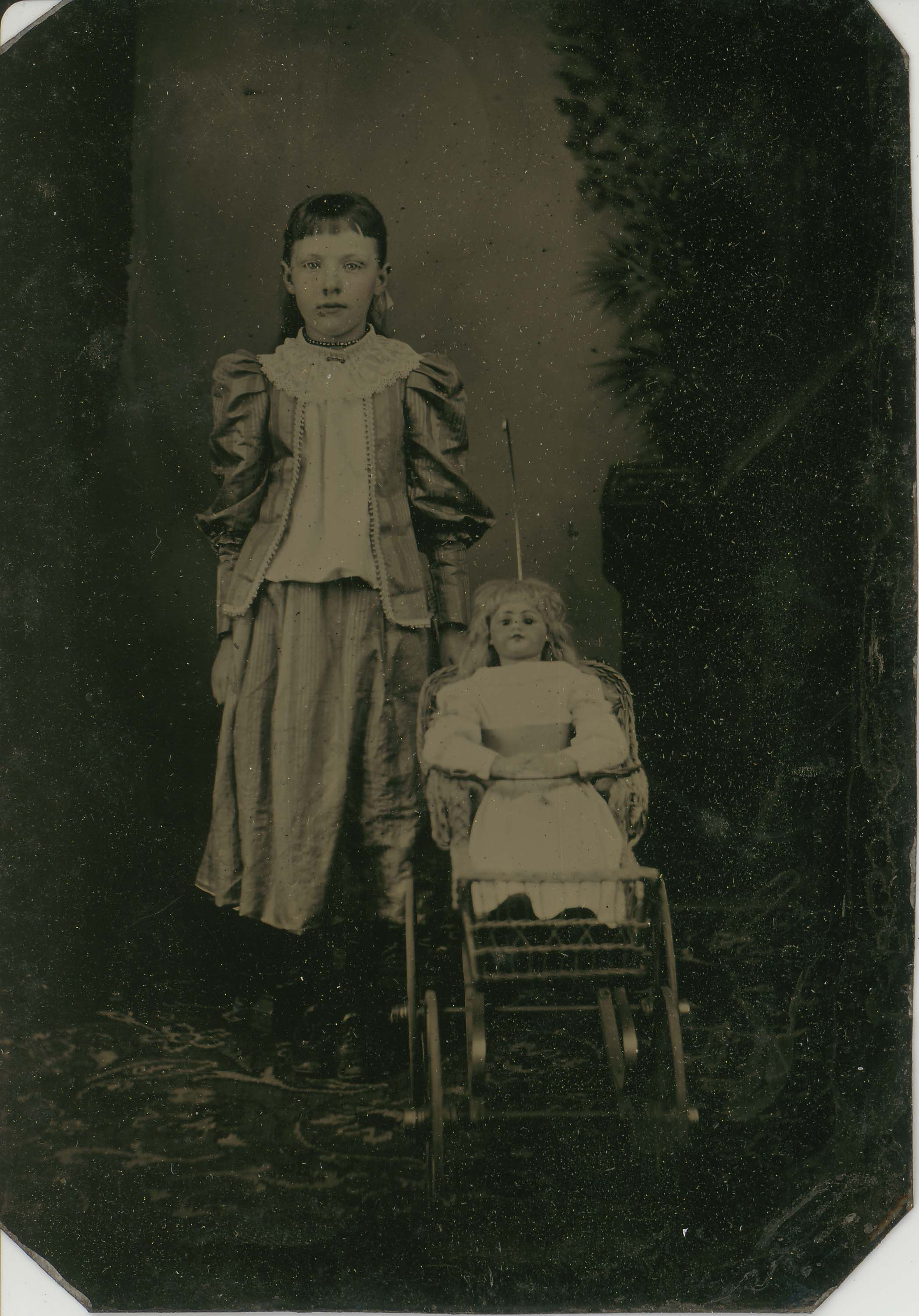 Tin-type-5-Girl-with-doll-in-wicker-pram