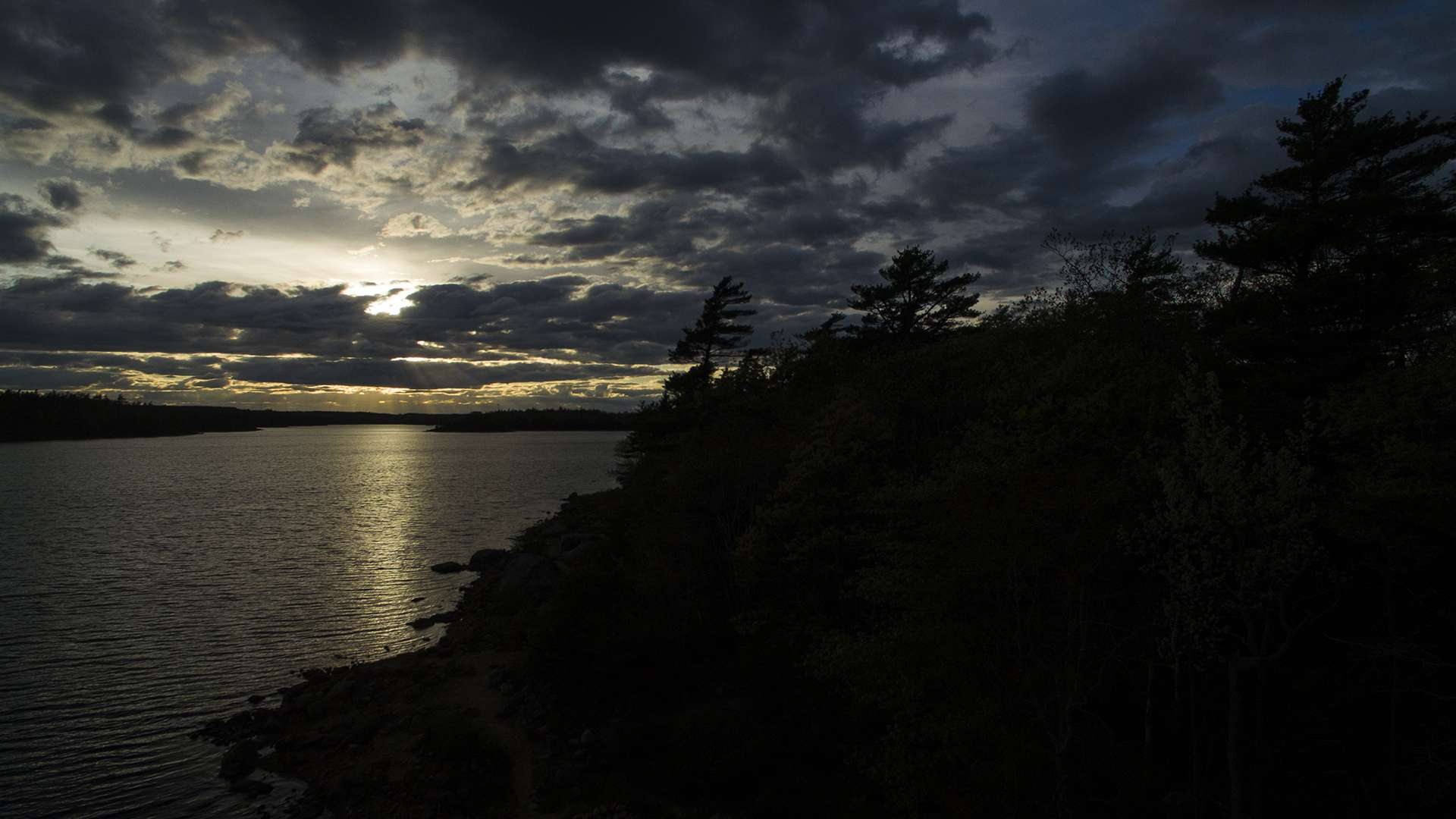 The sun sets among the clouds on June 1, 2020 at Long Lake Provincial Park in Spryfield, Nova Scotia.