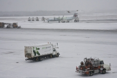 An Air Canada Express plane gets de-iced while other vehicles make thier way around the taramac at Halifax's Stanfield airport on a snowy Friday. Friday January 6, 2017. (Mike Harvey)