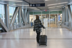 A passenger makes her way into the terminal at Halifax's Stanfield airport on January 6, 2017. (Mike Harvey)