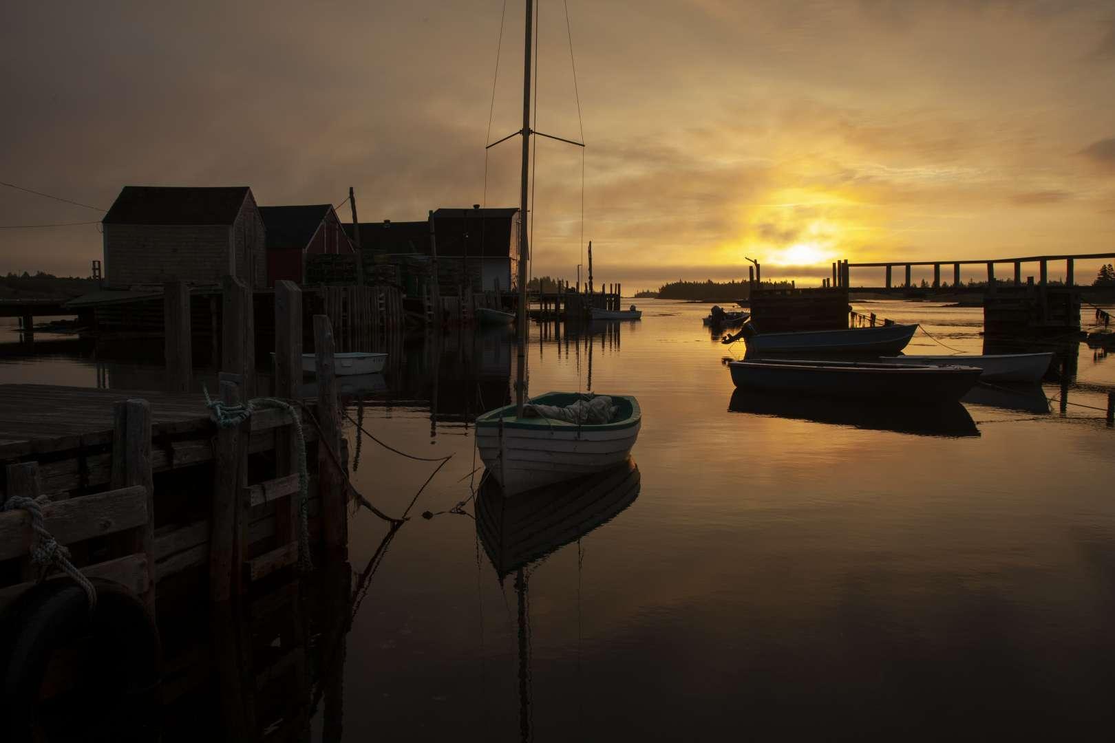 The Sun rises over the fishing village Blue Rocks, Lunenburg County, Nova Scotia.
